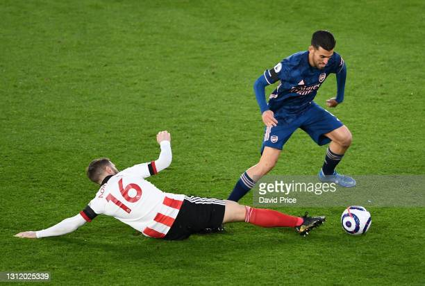 Dani Ceballos of Arsenal takes on Oliver Norwood of Sheffield United during the Premier League match between Sheffield United and Arsenal at Bramall...