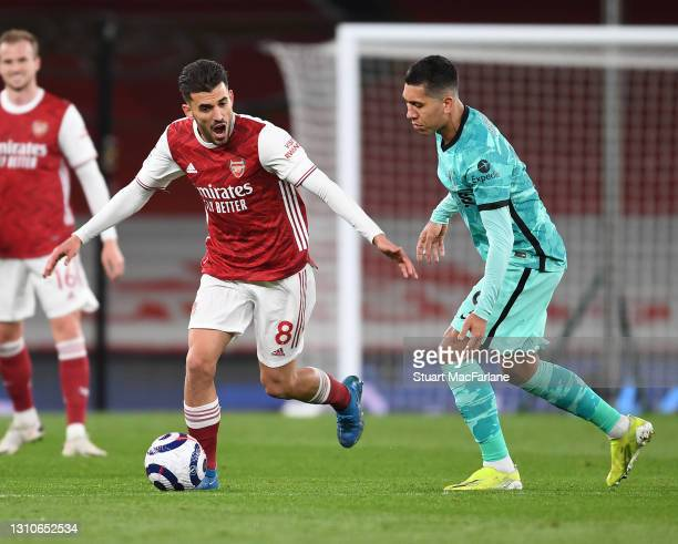 Dani Ceballos of Arsenal takes on Roberto Firmino of Liverpool during the Premier League match between Arsenal and Liverpool at Emirates Stadium on...