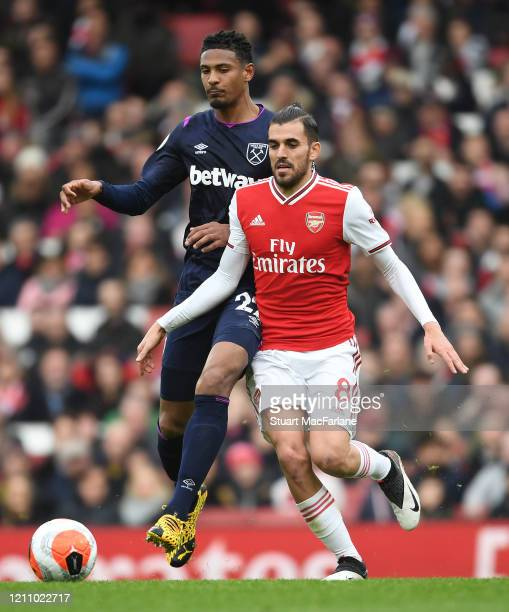 Dani Ceballos of Arsenal takes on Sebastien Haller of West Ham during the Premier League match between Arsenal FC and West Ham United at Emirates...