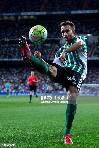 Dani Ceballos of Real Betis Balompie strikes the ball during the La Liga match between Real Madrid CF and Real Betis Balompie at Estadio Santiago...