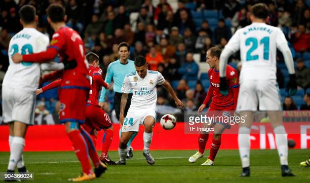 Dani Ceballos of Real Madrid and a player of Numancia battle for the ball during the Spanish Copa del Rey match between Real Madrid and Numancia at...