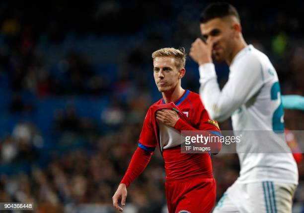 Dani Ceballos of Real Madrid and a player of Numancia look on during the Spanish Copa del Rey match between Real Madrid and Numancia at Santiago...