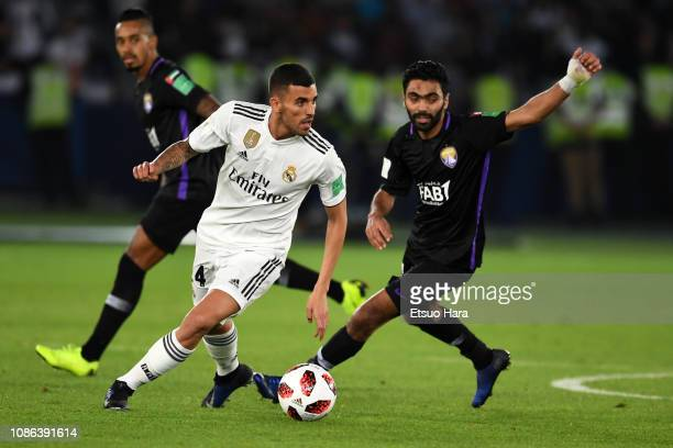 Dani Ceballos of Real Madrid and Hussein Elshahat of Al Ain compete for the ball during the FIFA Club World Cup UAE 2018 Final between Real Madrid...