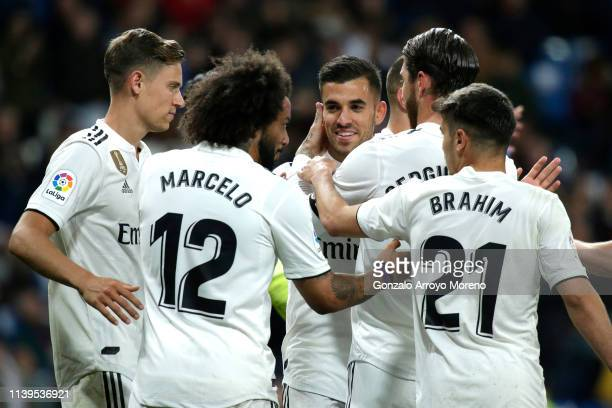 Dani Ceballos of Real Madrid celebrates with team mates after scoring his sides second goal during the La Liga match between Real Madrid CF and SD...