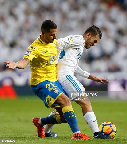 Dani Ceballos of Real Madrid CF duels for the ball with Vitolo Machin of Las Palmas during the La Liga match between Real Madrid and Las Palmas at...