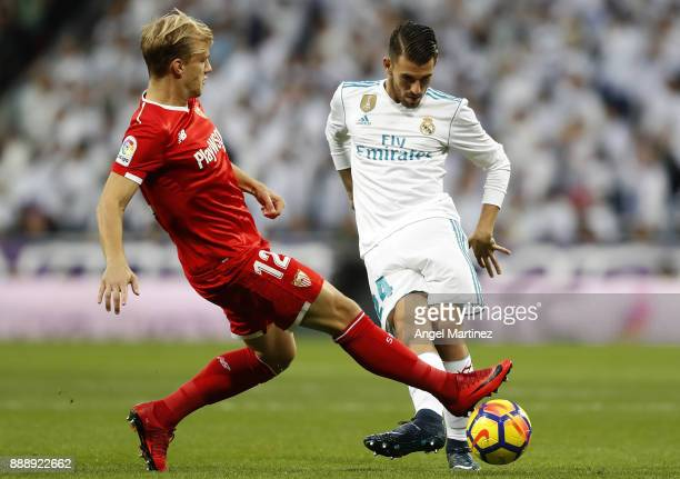 Dani Ceballos of Real Madrid competes for the ball with Johannes Geis of Sevilla during the La Liga match between Real Madrid and Sevilla at Estadio...