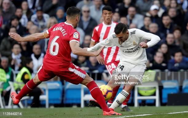 Dani Ceballos of Real Madrid in action against Alex Granell of Girona during the La Liga week 24 football match between Real Madrid and Girona at...