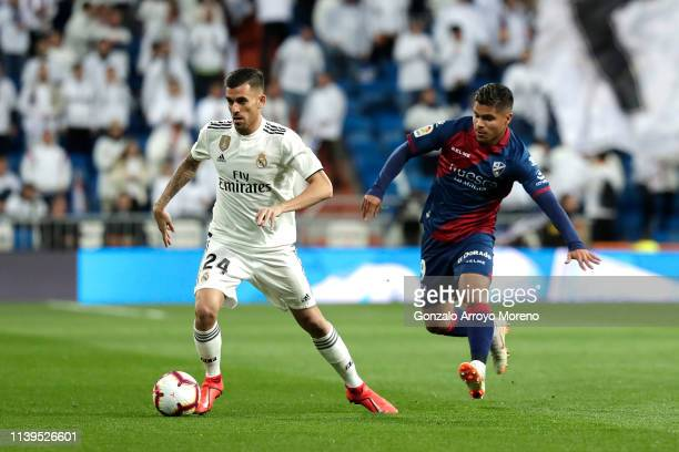 Dani Ceballos of Real Madrid is closed down by Camilo Hernandez of Huesca during the La Liga match between Real Madrid CF and SD Huesca at Estadio...