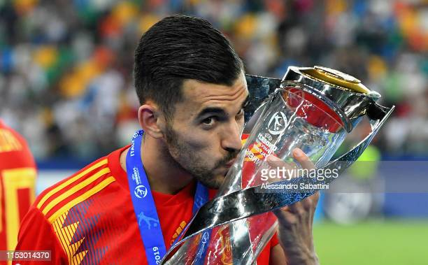 Dani Ceballos of Spain celebrates the victory with the trophy at the end the 2019 UEFA U-21 Final between Spain and Germanyat Stadio Friuli on June...