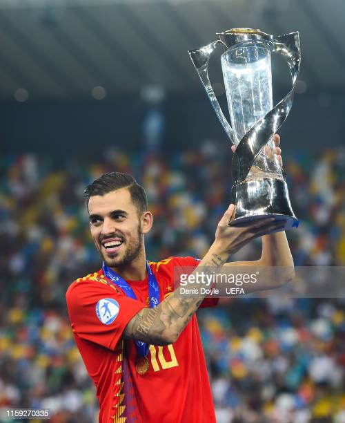 Dani Ceballos of Spain celebrates with the trophy winning the 2019 UEFA U-21 Final between Spain and Germany at Stadio Friuli on June 30, 2019 in...