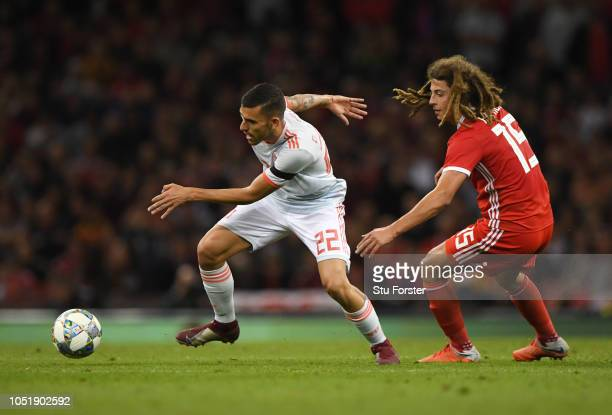 Dani Ceballos of Spain evades Ethan Ampadu of Wales during the International Friendly match between Wales and Spain on October 11 2018 in Cardiff...
