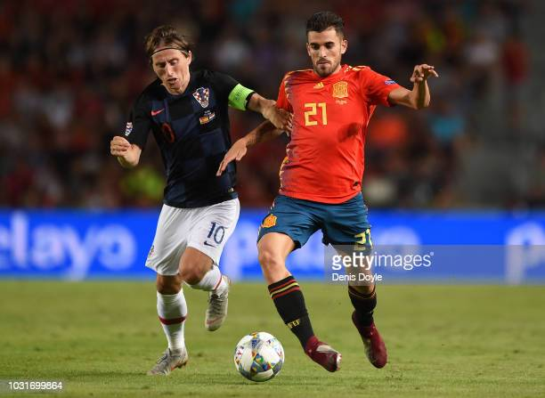 Dani Ceballos of Spain is challenged by Luka Modric of Croatia during the UEFA Nations League A group four match between Spain and Croatia at Estadio...