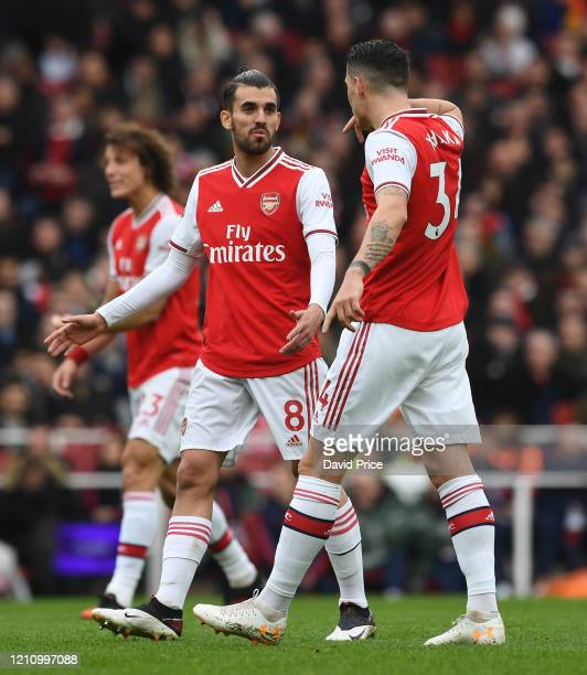 Dani Cebalos chats to Granit Xhaka of Arsenal during the Premier League match between Arsenal FC and West Ham United at Emirates Stadium on March 07...
