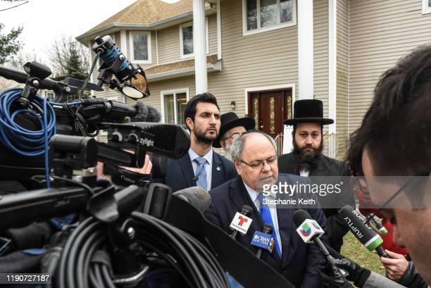 Dani Dayan Consul General of Israel in New York speaks to reporters outside the house of Rabbi Chaim Rottenberg on December 29 2019 in Monsey New...