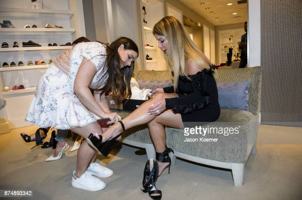 Dani de Cespedes helps Lily Lazaro try on shoes at Saks Fifth Avenue Bal Harbour on November 15 2017 in Bal Harbour Florida