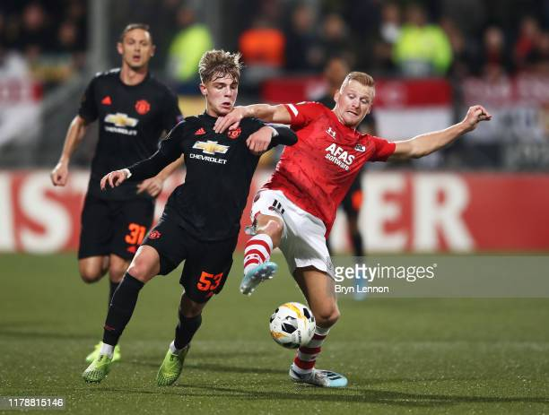 Dani de Wit of AZ Alkmaar battles for possession with Brandon Williams of Manchester United during the UEFA Europa League group L match between AZ...