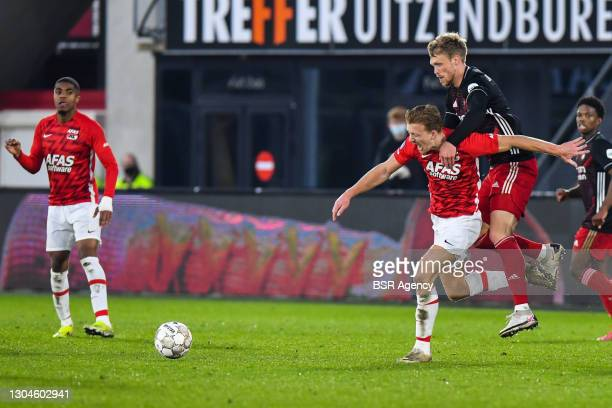 Dani de Wit of AZ and Nicolai Jorgensen of Feyenoord during the Dutch Eredivisie match between AZ and Feyenoord at AFAS Stadion on February 28, 2021...
