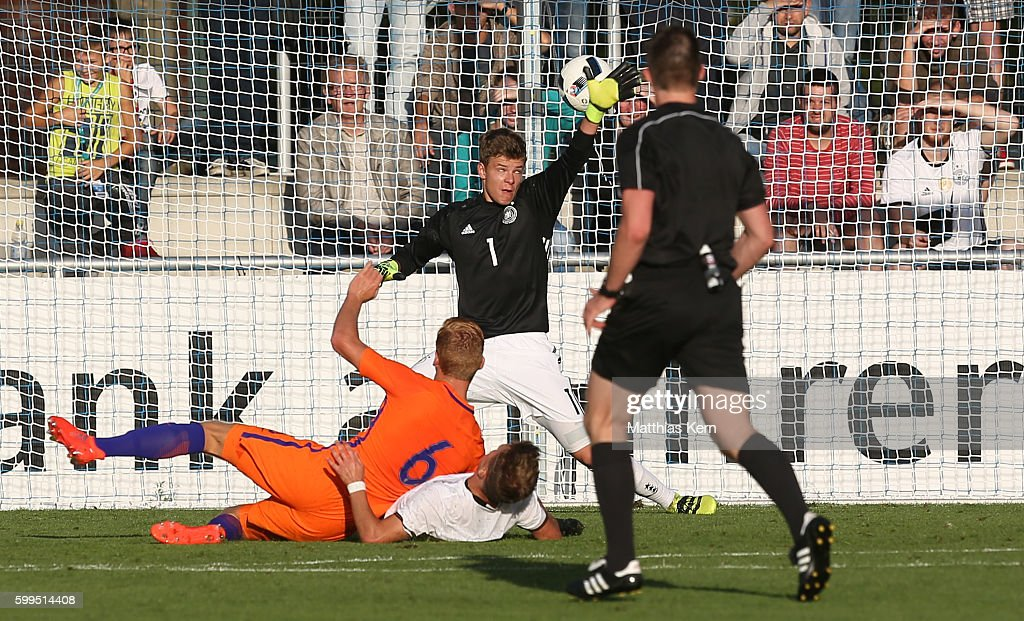 Dani de Wit (L) of the Netherlands scores the first goal during the international friendly match between U19 Germany and U19 Netherlands on September 5, 2016 in Luckenwalde, Germany.