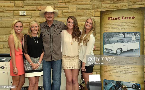 Dani Denise Alan Ali and Mattie Jackson pose by Jackson's 1955 Ford Thunderbird at the opening of his 'Alan Jackson 25 Years of Keepin' It Country'...