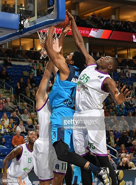 Dani Diez of Unicaja CB Malaga Malcolm Miller of Alba Berlin and Hamada Ndiaye of Unicaja CB Malaga during the game between Alba Berlin and Unicaja...