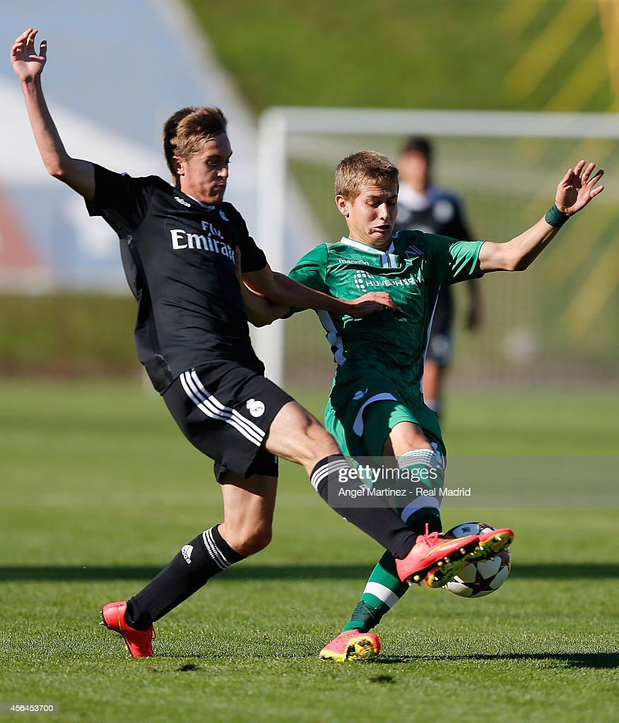Dani Fernandez of Real Madrid Academy competes for the ball with Denislav Aleksandrov of Ludogorets during the UEFA Youth Champions League match between PFC Ludogorets Razgrad and Real Madrid at Georgi Asparuhov Stadion on October 1, 2014 in Sofia, Bulgaria.