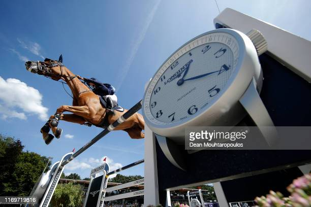 Dani G. Waldman of Israel riding Lizziemary competes during Day 4 of the Longines FEI Jumping European Championship 2nd part, team Jumping 1st round...