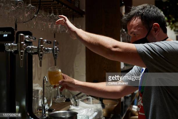 Dani Garcia taps a beer in his restaurant Casa Dani on May 25 2020 in Madrid Spain Some parts of Spain have entered the socalled Phase One or Phase...