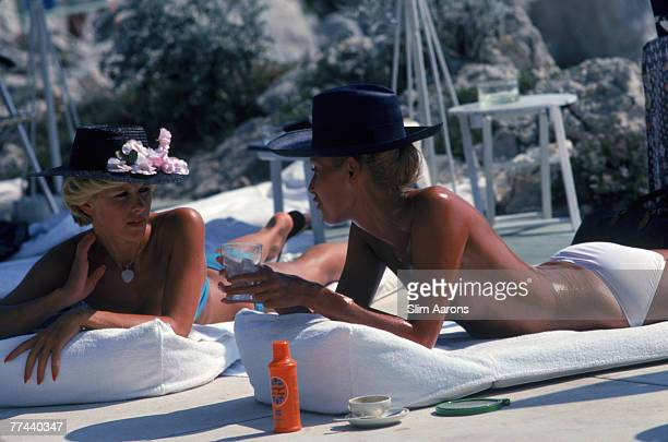 Dani Geneux and MarieEugenie Gaudfrin sunbathing at the Hotel du Cap EdenRoc Antibes France August 1976