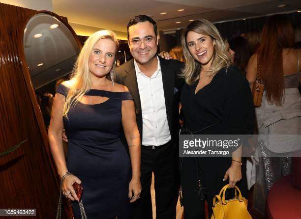 Dani Guardini Christiano Marchesini and Flavia Marchesini are seen at the Alexandre Birman Bal Harbor Store Opening Event on November 8 2018 in Miami...