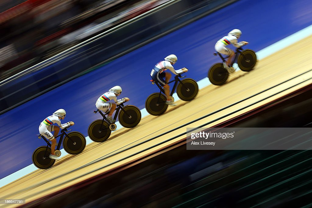 Dani King, Elinor Barker, Joanna Rowsell and Laura Trott of Great Britain in action on their way to setting a new world record time of 4:23.910 during the Women's Team Pursuit Qualifying round on day one of the UCI Track Cycling World Cup at Manchester Velodrome on November 1, 2013 in Manchester, England.