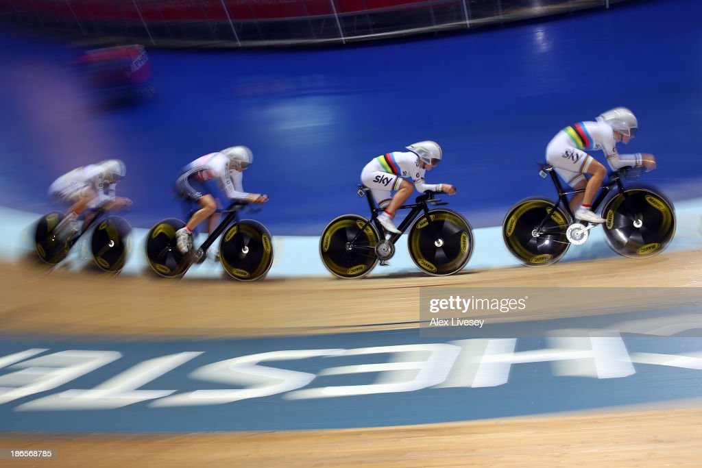 Dani King, Elinor Barker, Joanna Rowsell and Laura Trott of Great Britain in action on their way to winning gold and setting a new world record time of 4:19.604 during the Women's Team Pursuit Finals on day one of the UCI Track Cycling World Cup at Manchester Velodrome on November 1, 2013 in Manchester, England.