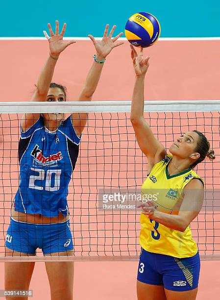 Dani Lins of Brazil spikes the ball as Anna Danesi of Italy defend during the match between Brazil and Italy on day 1 the FIVB Volleyball World Grand...