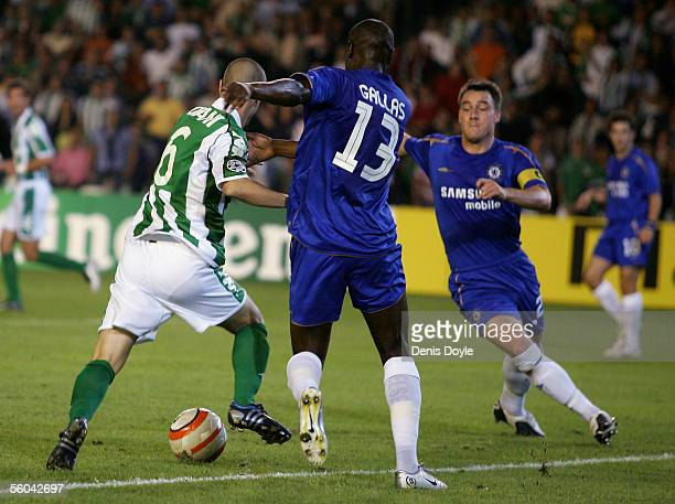 Dani of Betis scores a goal in front of William Gallas and John Terry of Chelsea during a UEFA Champions League group G match between Real Betis and...