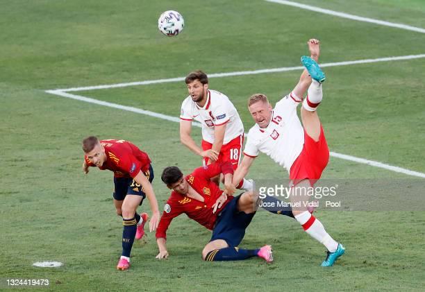 Dani Olmo and Alvaro Morata of Spain battles for possession with Bartosz Bereszynski and Kamil Glik of Poland during the UEFA Euro 2020 Championship...