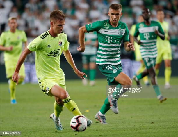 Dani Olmo of GNK Dinamo Zagreb dribbles next to Eldar Civic of Ferencvarosi TC during the UEFA Champions League Third Qualifying Round match between...