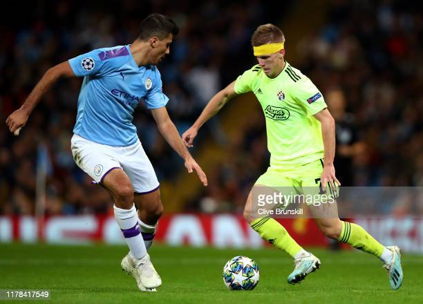Dani Olmo of GNK Dinamo Zagreb is challenged by Rodrigo of Manchester City during the UEFA Champions League group C match between Manchester City and...