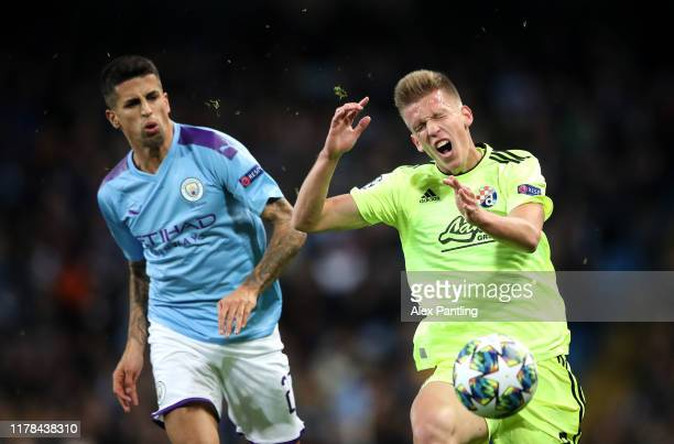 Dani Olmo of GNK Dinamo Zagreb reacts to a tackle from Joao Cancelo of Manchester City during the UEFA Champions League group C match between...