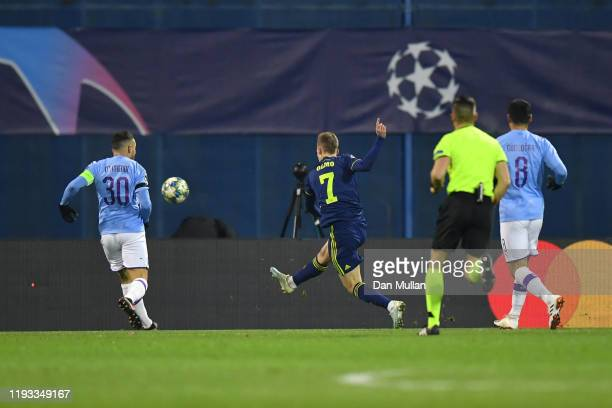 Dani Olmo of GNK Dinamo Zagreb scores his team's first goal past Nicolas Otamendi of Manchester City during the UEFA Champions League group C match...