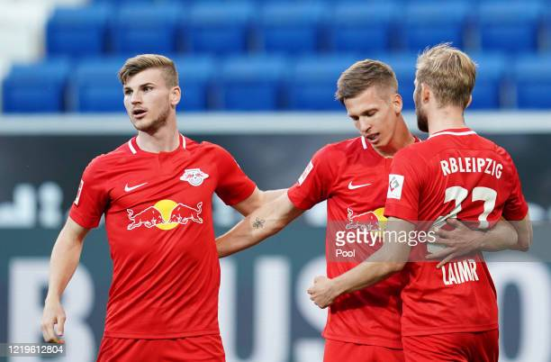 Dani Olmo of Leipzig celebrates after scoring his sides first goal with Timo Werner during the Bundesliga match between TSG 1899 Hoffenheim and RB...