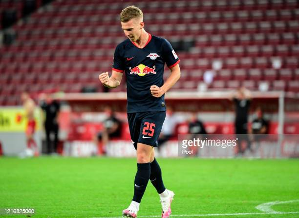 Dani Olmo of Leipzig celebrates scoring his sides fourth goal during the Bundesliga match between 1. FC Koeln and RB Leipzig at RheinEnergieStadion...