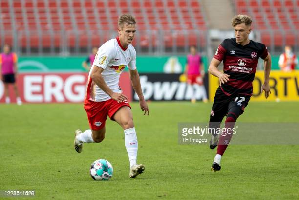 Dani Olmo of RB Leipzig and Robin Hack of 1FC Nuernberg during the DFB Cup first round match between 1 FC Nuernberg and RB Leipzig at...