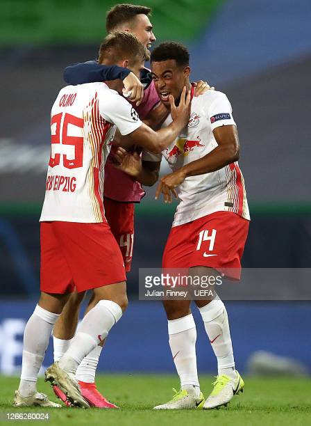 Dani Olmo of RB Leipzig and Tyler Adams of RB Leipzig celebrate following their team's victory in the UEFA Champions League Quarter Final match...