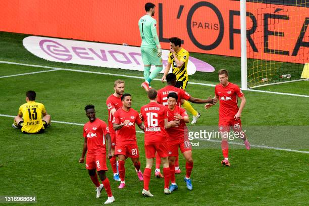 Dani Olmo of RB Leipzig celebrates after scoring their team's second goal with team mates after scoring their side's second goal during the...