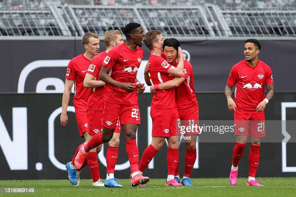 Dani Olmo of RB Leipzig celebrates with Hee-Chan Hwang after scoring their side's second goal during the Bundesliga match between Borussia Dortmund...