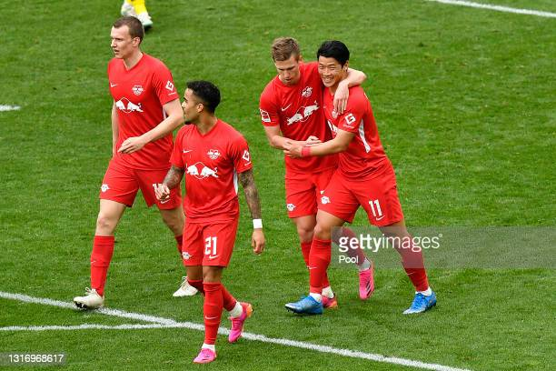 Dani Olmo of RB Leipzig celebrates with Hwang Hee-chan after scoring their team's second goal during the Bundesliga match between Borussia Dortmund...
