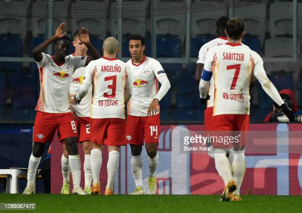 Dani Olmo of RB Leipzig celebrates with team mates Amadou Haidara, Angelino and Tyler Adams after scoring their sides third goal during the UEFA...