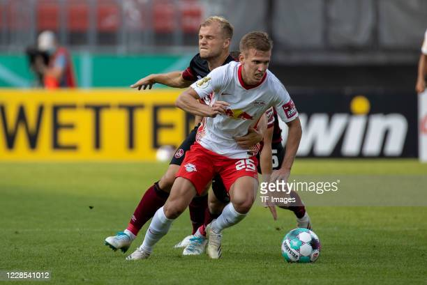 Dani Olmo of RB Leipzig Fabian Nuernberger of 1FC Nuernberg and Johannes Geis of 1FC Nuernberg during the DFB Cup first round match between 1 FC...