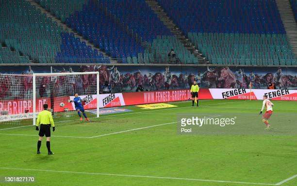 Dani Olmo of RB Leipzig scores their team's first goal from the penalty spot during the Bundesliga match between RB Leipzig and FC Augsburg at Red...