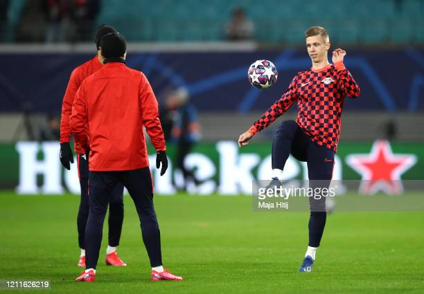 Dani Olmo of RB Leipzig warms up ahead of the UEFA Champions League round of 16 second leg match between RB Leipzig and Tottenham Hotspur at Red Bull...