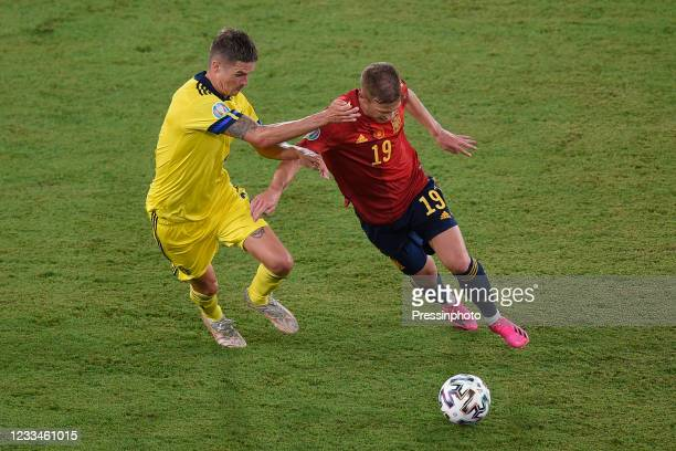 Dani Olmo of Spain and Mikael Lustig of Sweden during the match between Spain and Sweden of Euro 2020, group E, matchday 1, played at La Cartuja...